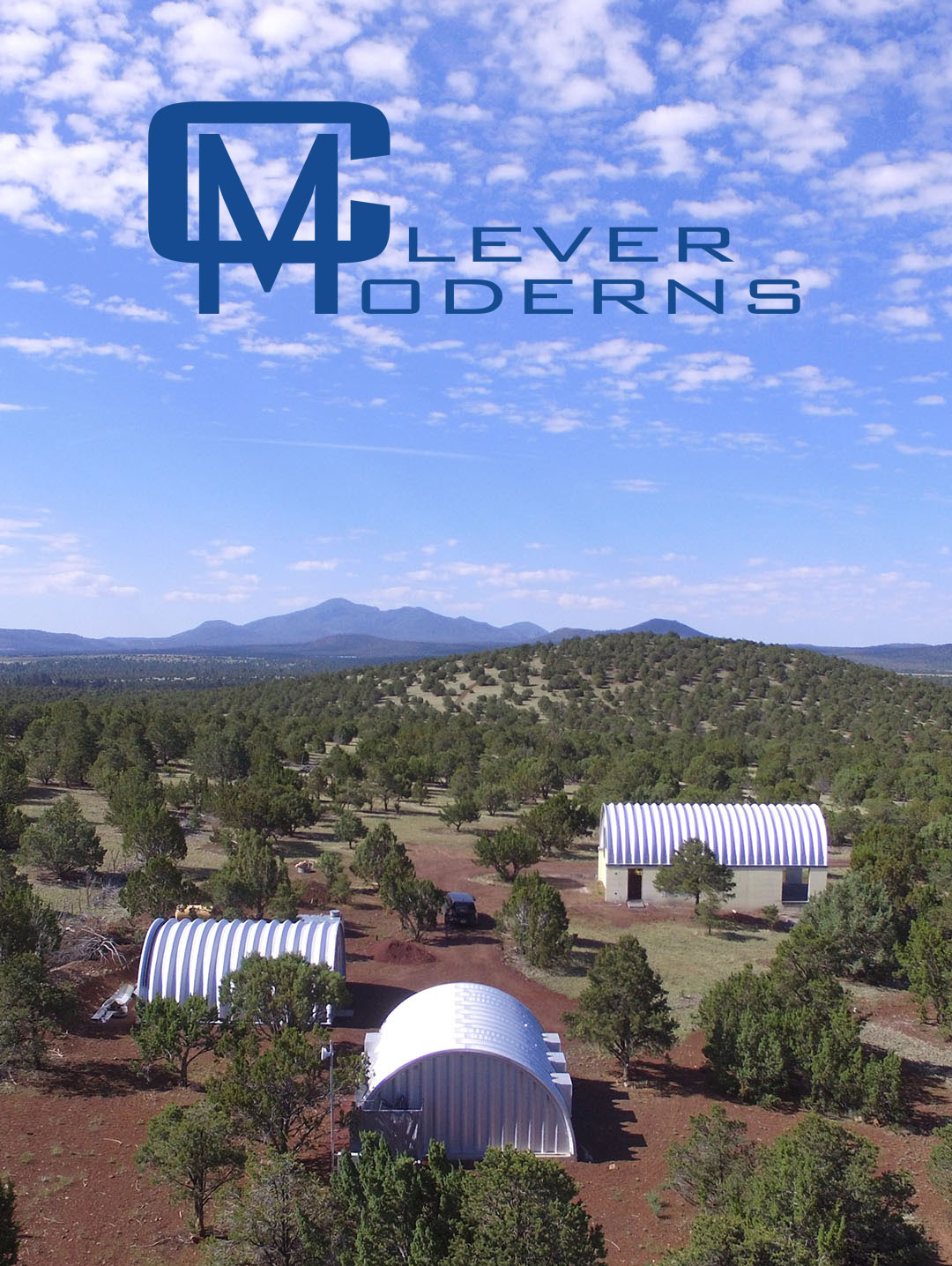 Aerial image of mountain landscape with Quonset huts.
